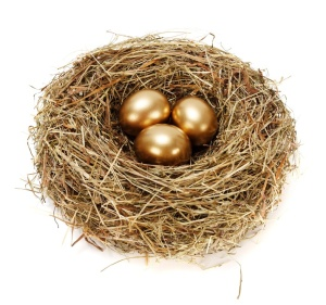 Three golden eggs in hay nest